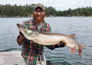 Man holding a Large Northern pike caught in Lake of the Woods